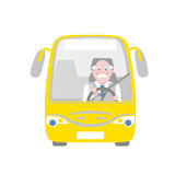 Bus driver. Elderly silver-haired moustached driver in the yellow bus Stock Image