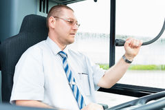 Bus driver making announcement using microphone Royalty Free Stock Images
