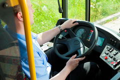 Bus driver sitting in his bus Royalty Free Stock Photography