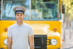 Bus driver smiling in front of bus. Portrait of bus driver smiling in front of bus Royalty Free Stock Image