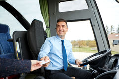 Bus driver taking ticket or card from passenger Royalty Free Stock Photo