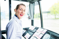 Bus driver woman selling tickets Stock Photos