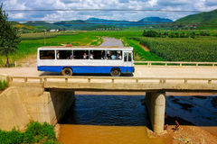 The bus driving on the bridge in a unknown countryside of North Korea, DPRK. Photographed in pyongyang, north korea DPRK Stock Images