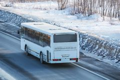Bus is driving on a country road Stock Photography