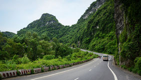 A bus driving on moutain road in Haiphong Stock Photos