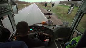 Bus driving at rainy day stock video footage