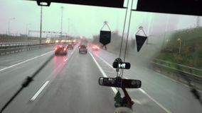 Bus driving at rainy day stock video