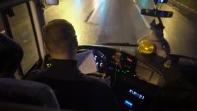 Bus driving at rainy night. Window stock footage