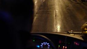 Bus driving at rainy night. Window stock video footage