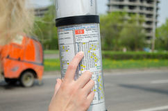 Bus driving schedule and hand of woman Royalty Free Stock Photography