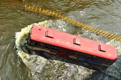 Bus drove on flood Stock Images