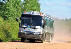 Bus on a dusty road Stock Photo