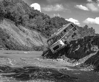 Bus on the edge. After flooding everything can be seen, this bus is an example royalty free stock photos