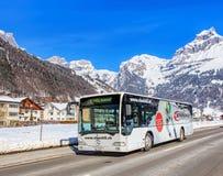 Bus on the Elgelbergerstrasse street in Engelberg, Switzerland. Engelberg, Switzerland - 9 March 2016: bus passing along the Elgelbergerstrasse street with Stock Photo