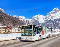 Bus on the Elgelbergerstrasse street in Engelberg, Switzerland Stock Photo