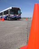 Bus et cône 3 de circulation Photos stock