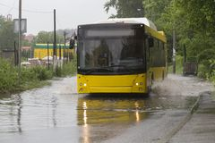 Bus in flood Royalty Free Stock Image