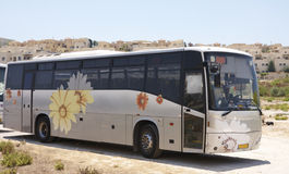 Bus with flowers. In a city environment Royalty Free Stock Photography