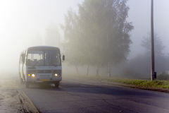 The bus in a fog Stock Photography