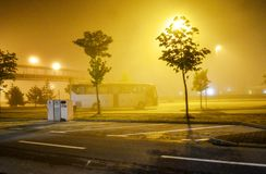 Bus in fog on road Royalty Free Stock Photos