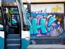 Bus in the front of Graffiti wall Royalty Free Stock Photos