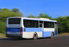Bus goes on country  highway Royalty Free Stock Images