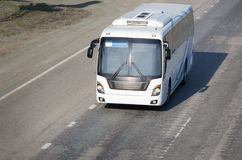 Bus goes on country  highway Royalty Free Stock Photography