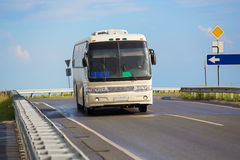 Bus goes on country highway Royalty Free Stock Photo