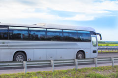 Bus goes on country highway Stock Image