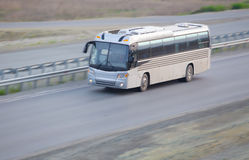 Bus goes on country highway Stock Photo