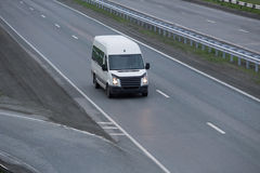 Bus goes on highway Stock Image