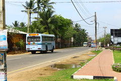 The bus goes on the road, the area Koggala Stock Photos