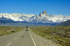 Bus going on road to mountain Fitz Roy in Patagonia Royalty Free Stock Photo