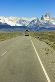 Bus going on road to mountain Fitz Roy in Patagonia Stock Photography