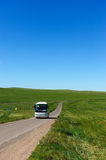 Bus in grassland Stock Image