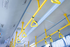 Bus handle. Handles for standing passenger inside a city-bus Royalty Free Stock Photo