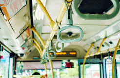 Bus handle interior. Bus handle for passenger inside bus. Interior of city bus Royalty Free Stock Images