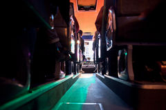Bus inside at night. Seats inside a tour bus driving at night by the city Stock Photo