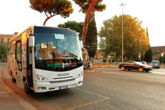 Bus ISUZU on street in Rome at sunrise Royalty Free Stock Images