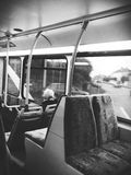 Bus journey. An old lady staring out the window on the bus Royalty Free Stock Photography