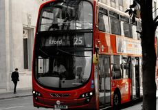 Modern red double-decker bus in London stock image