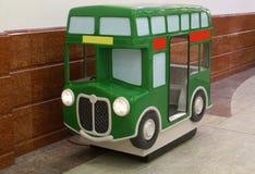 Bus kiddie ride game machine for children. Coin operated game machine or children leisure recreation amusement machine Royalty Free Stock Image