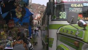 Bus in La Paz market street, Bolivia stock video