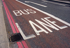 Bus lane. Red bus lane and arrows indicating the direction of traffic Stock Photo