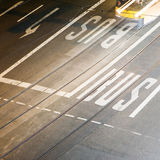 Bus lane. A bus lane with a bus on rails Stock Image