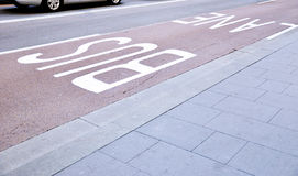 Bus lane in the city. Bus lane near footpath in the city Stock Photos