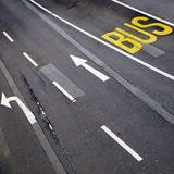 Bus lane and road markings. Overhead view of white line markings on road with bus lane Royalty Free Stock Photo