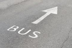 Bus Lane. Sign on the asphalt road Royalty Free Stock Photo