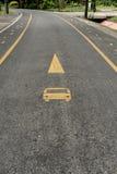 Bus lane sign on asphalt road. Yellow bus lane sign on asphalt road Royalty Free Stock Images