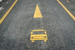 Bus lane sign on asphalt road. Yellow bus lane sign on asphalt road Stock Photos
